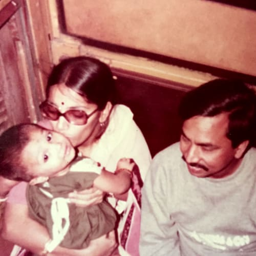 Nithya Bandi as a child, pictured with her parents.