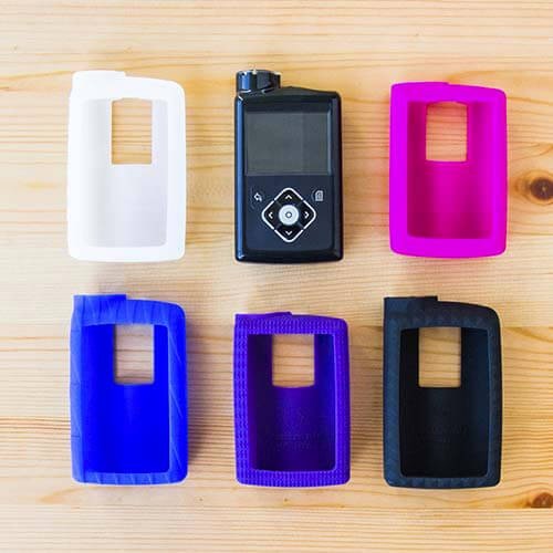 Showing the five color options for insulin pump cases: white, pink, blue, purple, and black.