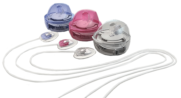 Three MiniMed Mio infusion sets in three different colors.