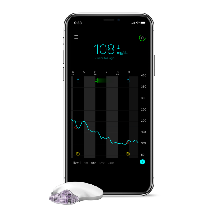 Guardian Connect CGM sensor sitting next to a smartphone with the app screen displayed.