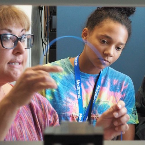 Nyah Johnson watches a Medtronic lab demonstration in Mounds View, MN