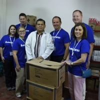 Employees participate in Americares airlift trip.