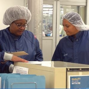 Employees hold each other accounatable on the manufacturing floor.