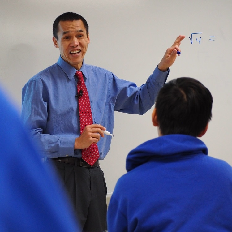 Viet Le teaching at St. Thomas Academy