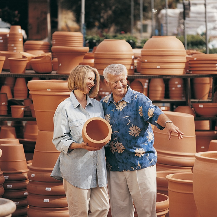Couple looking at garden pots