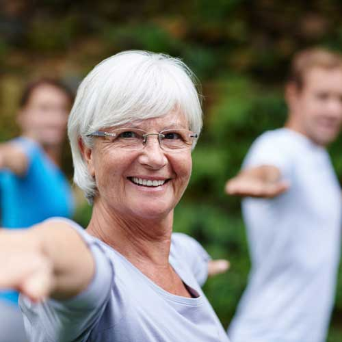 A group of older adults exercising together