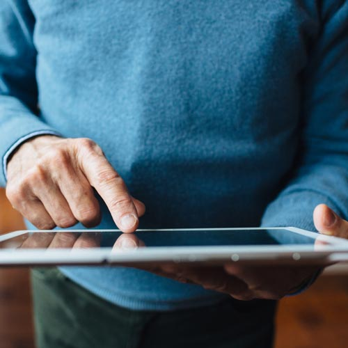 Older man using tablet
